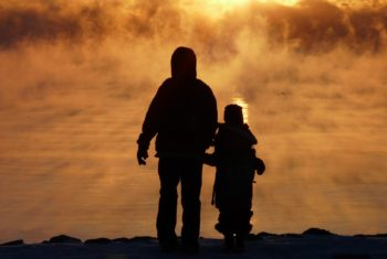 photo of parent and child walking