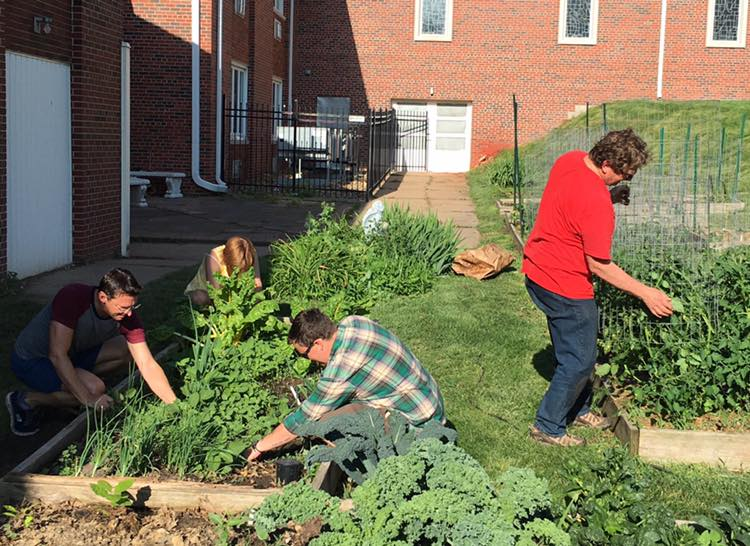 photo of church members gardening