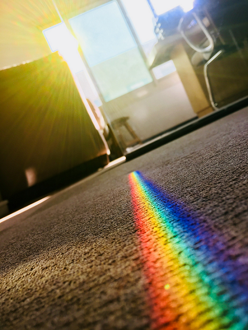 photo of rainbow coming through window
