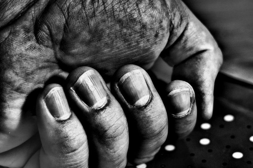 photo showing muddy hands