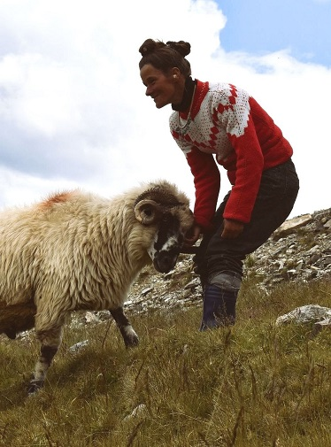 photo of a sheperdess with a sheep