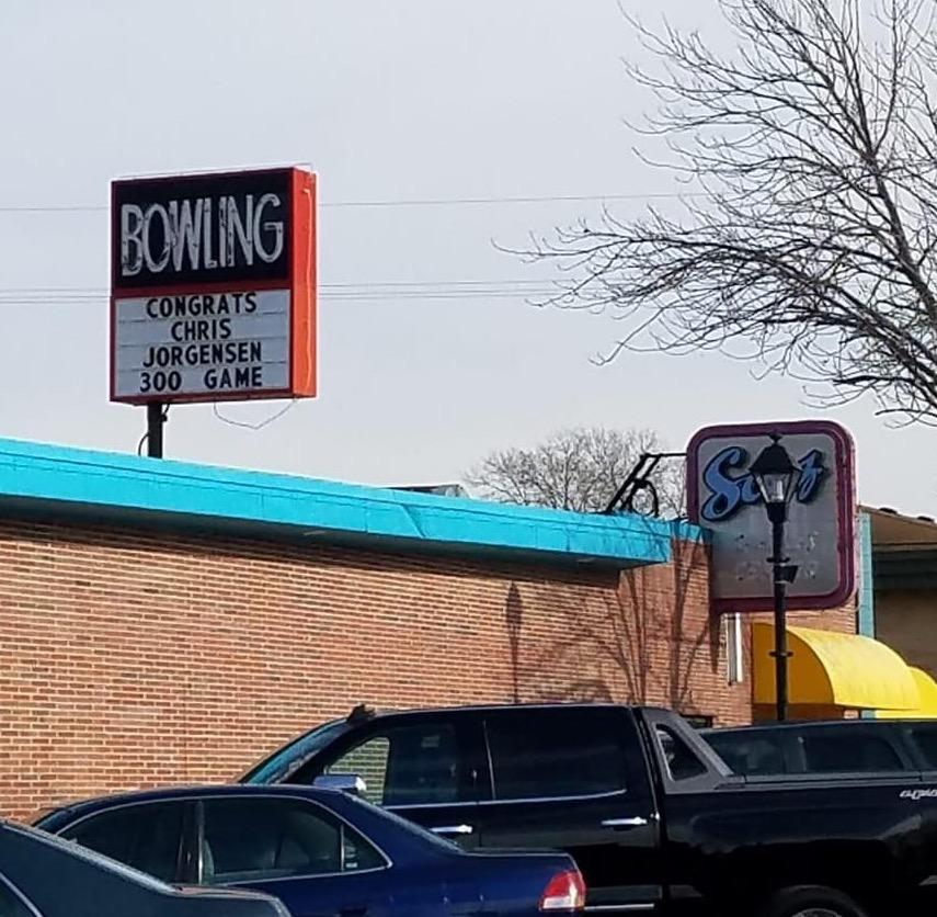 photo of a bowling alley sign showing chris jorgensen got a 300 score