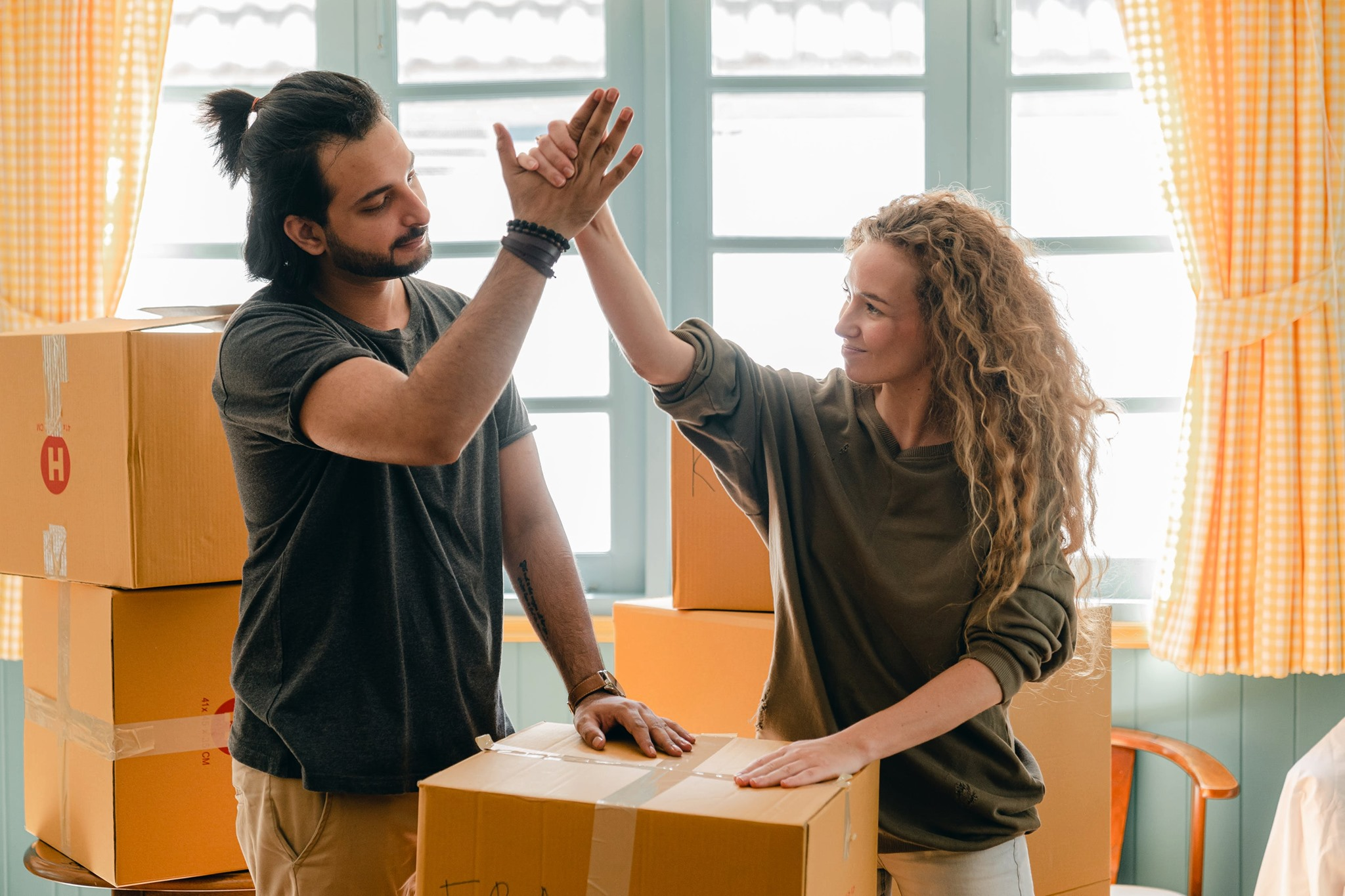 photo of two people high fiving